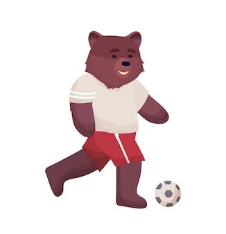 スポーツキャラクターのtシャツとショートパンツの漫画のキャラクターのクマのフットボール選手がサッカーボールを果たしています。