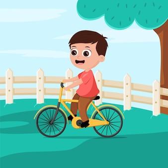 公園で自転車に乗る漫画の子供の男の子