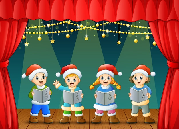 Cartoon children singing christmas carols on the stage