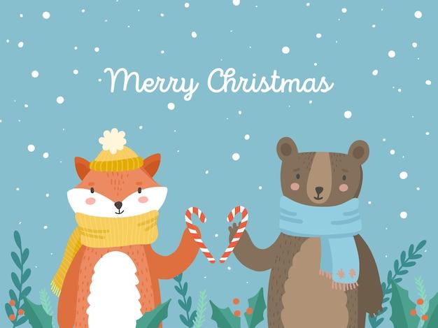 漫画のクリスマス動物キツネとキャンディーを保持しているクマ