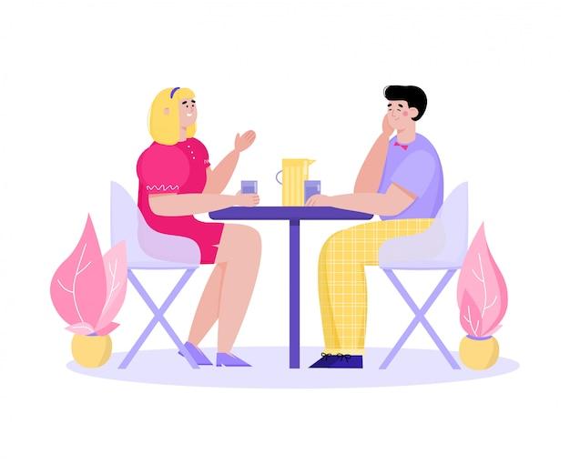 음료와 함께 테이블에 앉아 이야기 카페에서 만화 커플