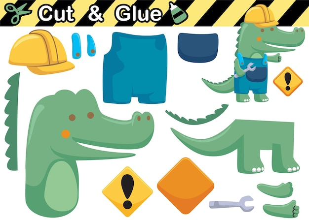 Cartoon of crocodile wearing worker uniform while holding monkey wrench. education paper game for children. cutout and gluing