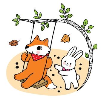 Cartoon cute hand draw fox and rabbit camping in autumn vector