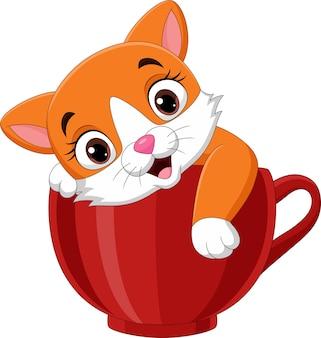 Мультяшный милый котенок сидит в красной чашке