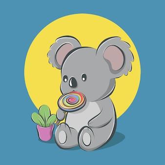 Cartoon cute koala sitting and eating candy