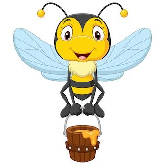 蜂蜜のバケツを保持している漫画かわいい小さな蜂