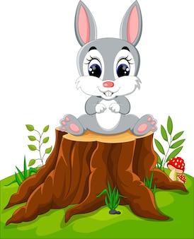 Cartoon easter bunny on tree stump