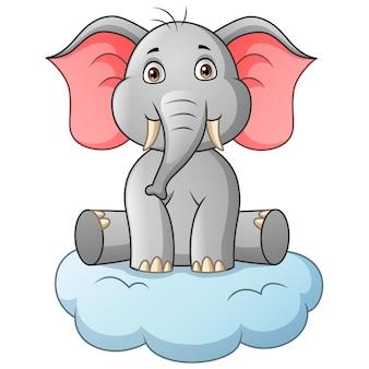 雲のイラストに座っている漫画の象
