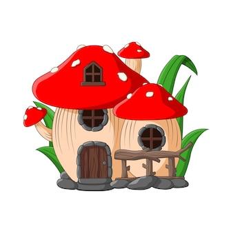 白い背景の上の漫画の妖精の家のキノコ