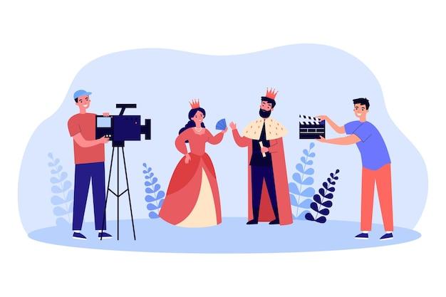 왕과 여왕에 관한 만화 영화 제작진 촬영 영화. 왕실 옷을 입은 배우와 여배우는 평평한 벡터 삽화를 가지고 있습니다. 배너, 웹 사이트 디자인 또는 방문 웹 페이지에 대한 영화, 미디어, 영화 촬영 개념