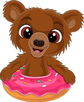 Мультфильм смешной медвежонок внутри пончик