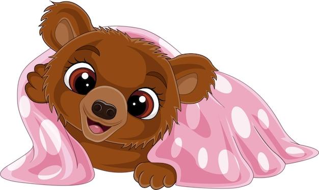 Мультяшный забавный медвежонок в розовом одеяле
