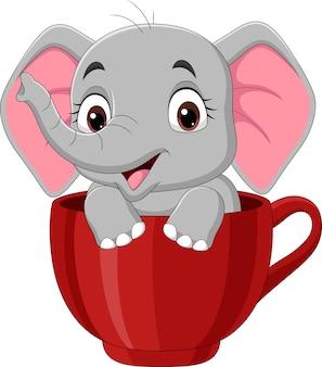 赤いカップに座っている漫画面白い赤ちゃん象