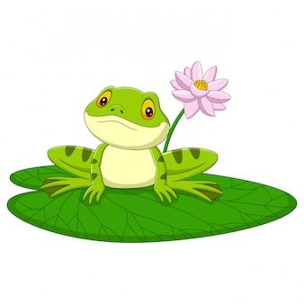 Cartoon green frog sitting on a leaf