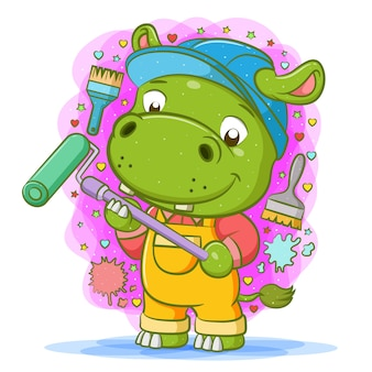 The cartoon of the green hippopotamus use the yellow overall and hold roller painter