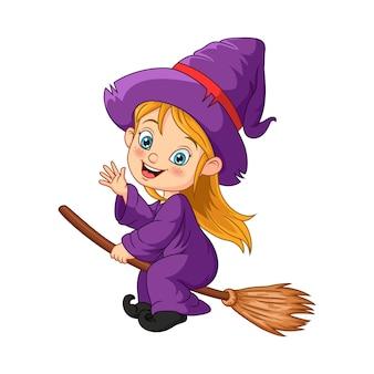 ほうきで飛んでいる漫画のハロウィーンの魔女の女の子