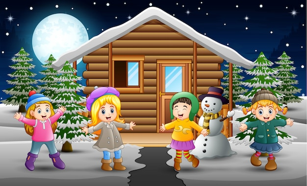 Cartoon of happy kids wearing a winter clothes in front of the snowing village