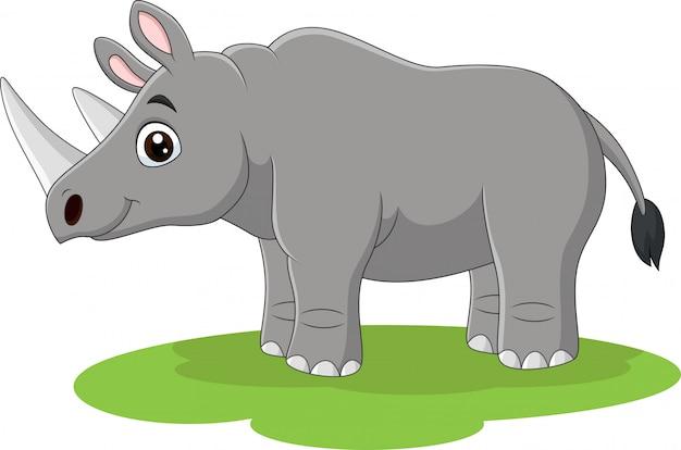 Cartoon happy rhino on the grass