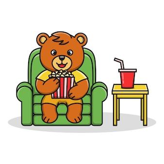 Cartoon illustration of a bear eating popcorn