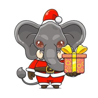 Иллюстрация шаржа милого талисмана слона в костюме санта-клауса, дающего подарочную коробку