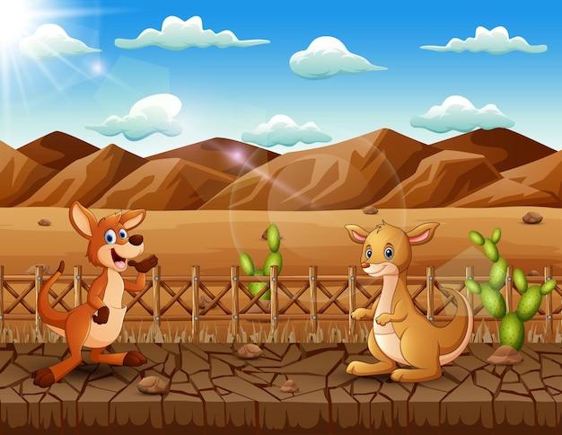 乾燥した土地の風景の中の漫画のカンガルー