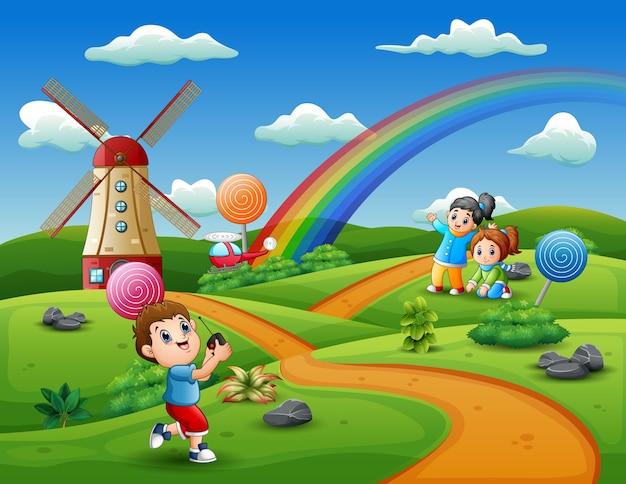キャンディーランドの背景で遊ぶ漫画の子供たち