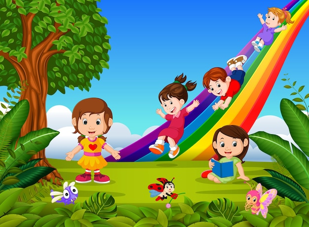 Cartoon kids sliding down the rainbow