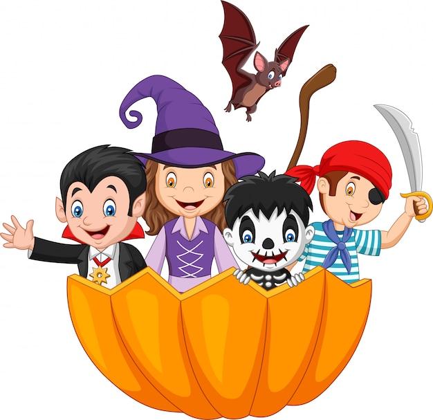 Cartoon kids with halloween costume inside pumpkin basket