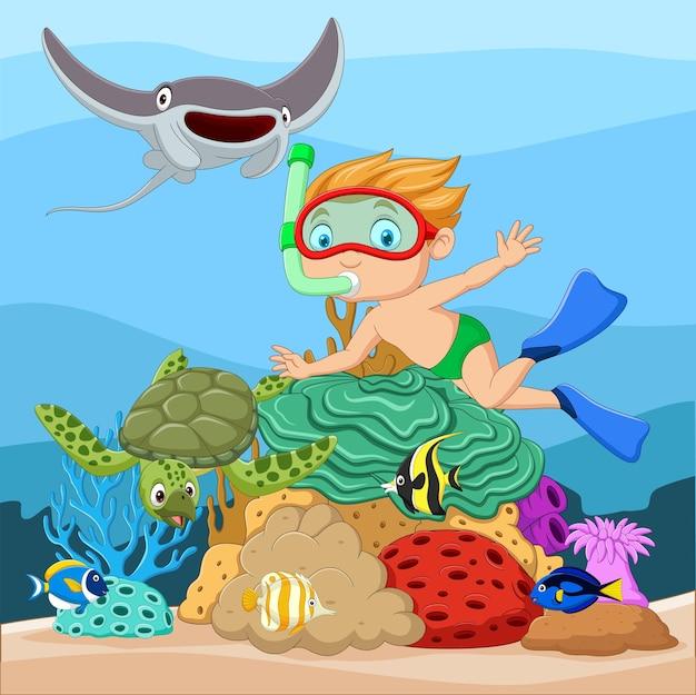 Cartoon little boy diving in underwater tropical sea