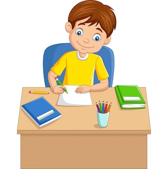 Cartoon little boy studying on the table