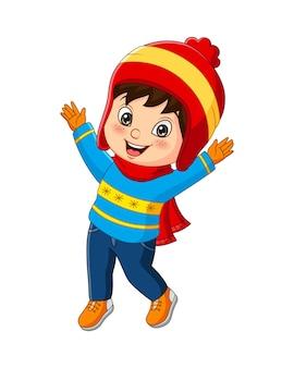 冬の服を着ている漫画の小さな男の子