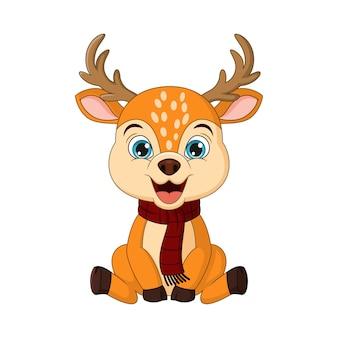 座っている漫画の小さなクリスマスの鹿