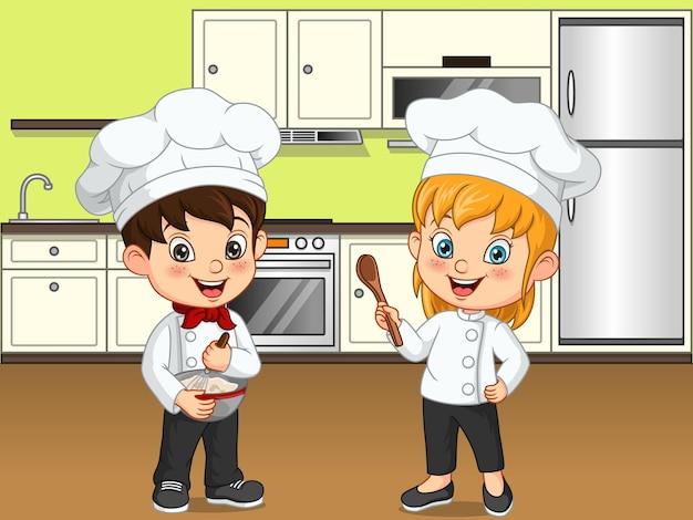 부엌에서 요리하는 만화 어린 아이들