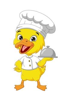 Мультяшный маленький желтый утенок шеф-повар держит серебряный поднос