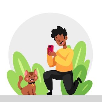 彼の猫の写真を撮る漫画の男