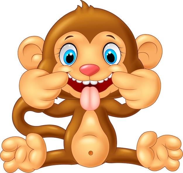 놀리는 얼굴을 만드는 만화 원숭이