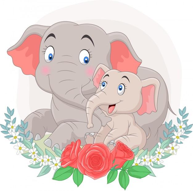 花の背景と座っている漫画の母親と赤ちゃん象