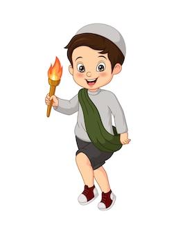 トーチを保持している漫画のイスラム教徒の少年
