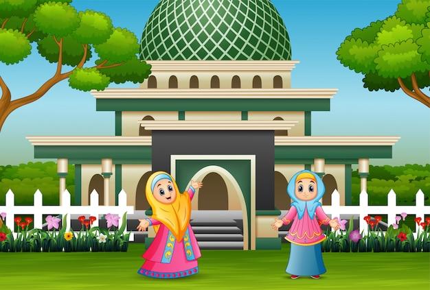 Cartoon muslim women posing in front the mosque