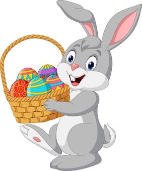 Мультяшный кролик держит пасхальную корзину