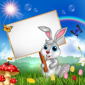 Cartoon rabbit holding blank sign with nature background