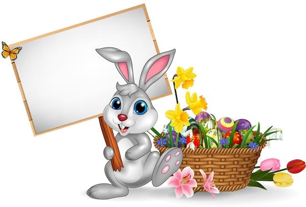 Cartoon rabbit holding blank sign