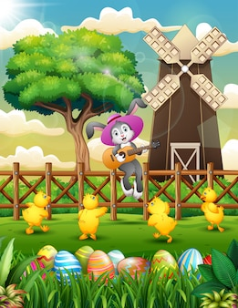 Cartoon rabbit playing guitar on the fence