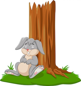 Cartoon rabbit sleeping under tree