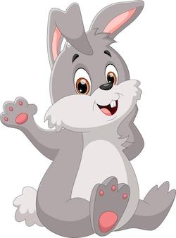 Мультфильм кролик машет изолирован на белом фоне