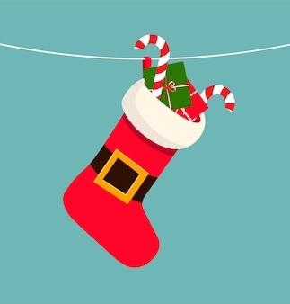 Мультяшный красно-белый носок с подарками чулок, висящий на веревке, праздник рождества и нового года