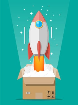 Cartoon rocket ejected from cardboard box. concept of startup, creative idea, leadership, business success or inspiration. space ship take off.