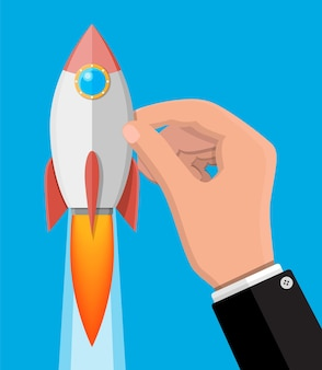 ビジネスマンの手で漫画のロケット