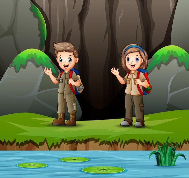 Cartoon of scout boy and girl exploring nature