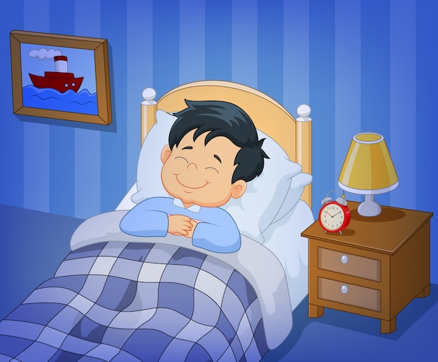 Cartoon smile little boy sleeping in the bed